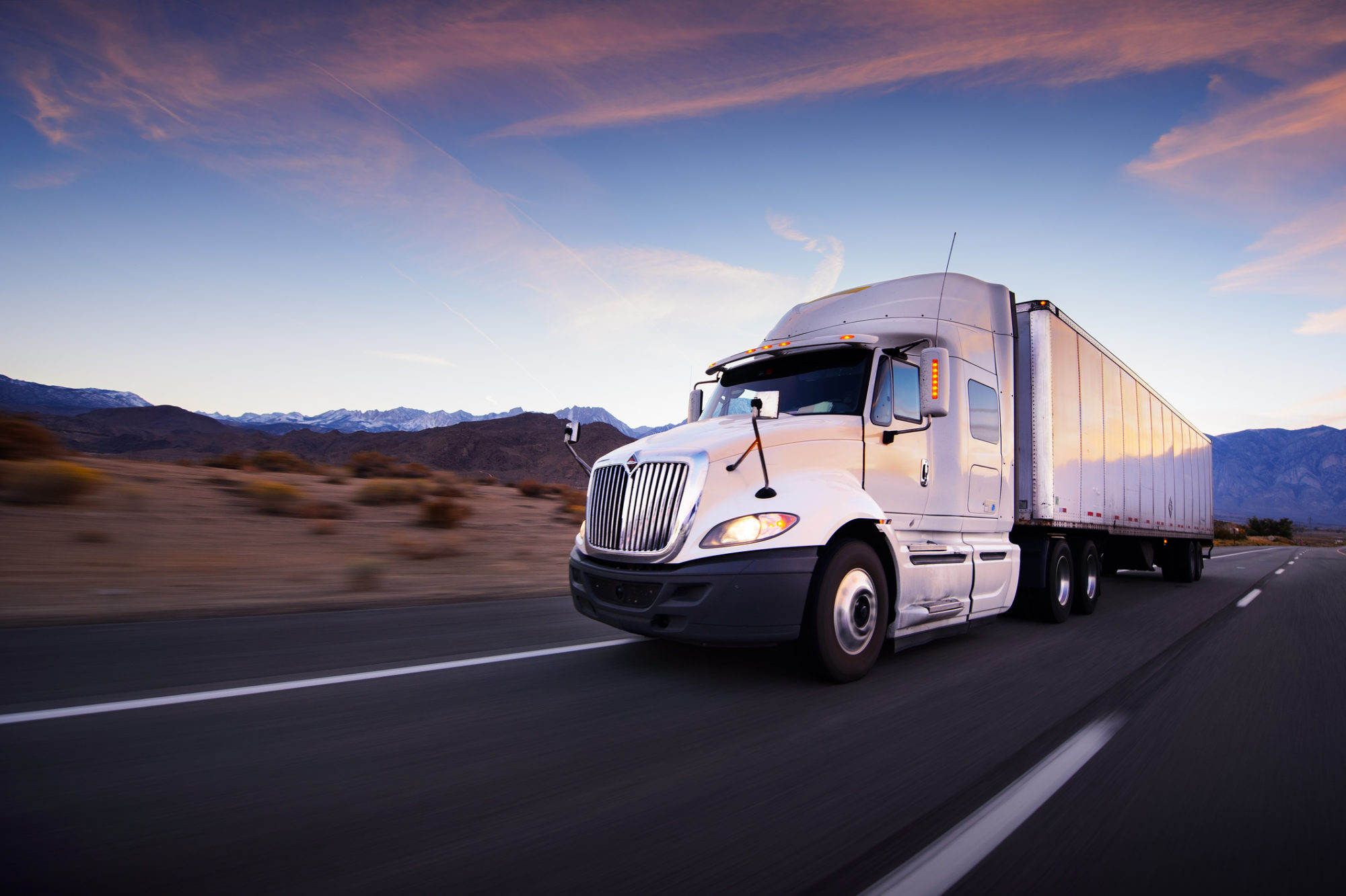 Truck and highway at sunset who may need a commercial truck accident attorney