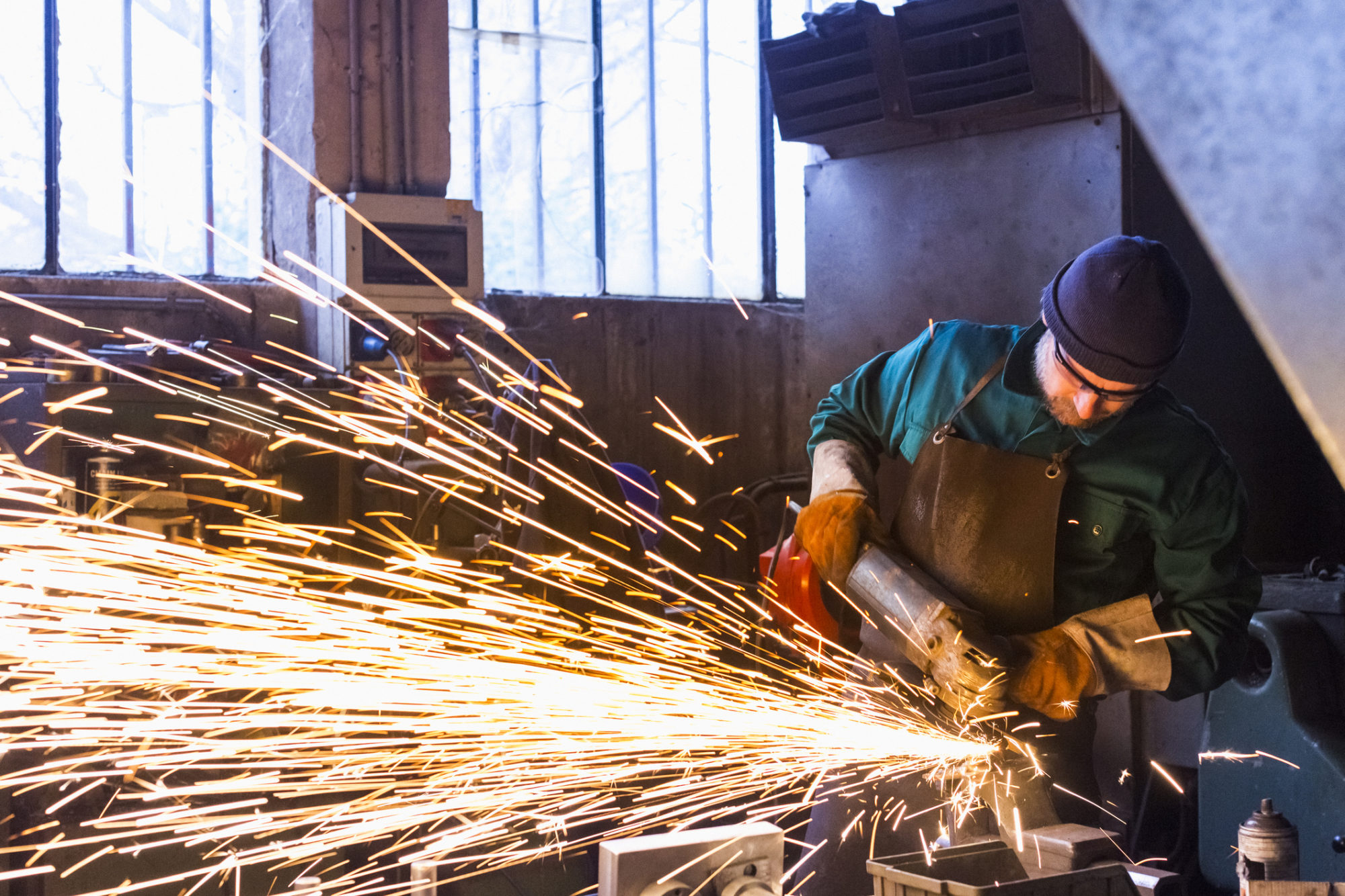 Worker with metal cutting grinder who may need a personal injury lawyer