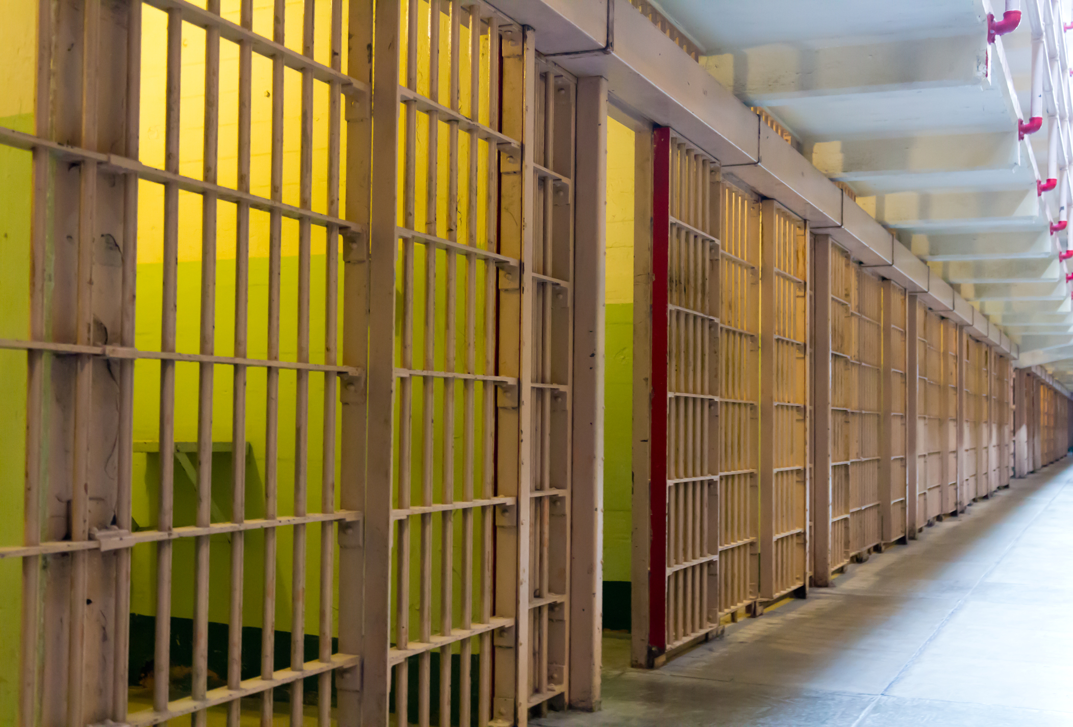 Prison cell bars for people who need a criminal defense lawyer