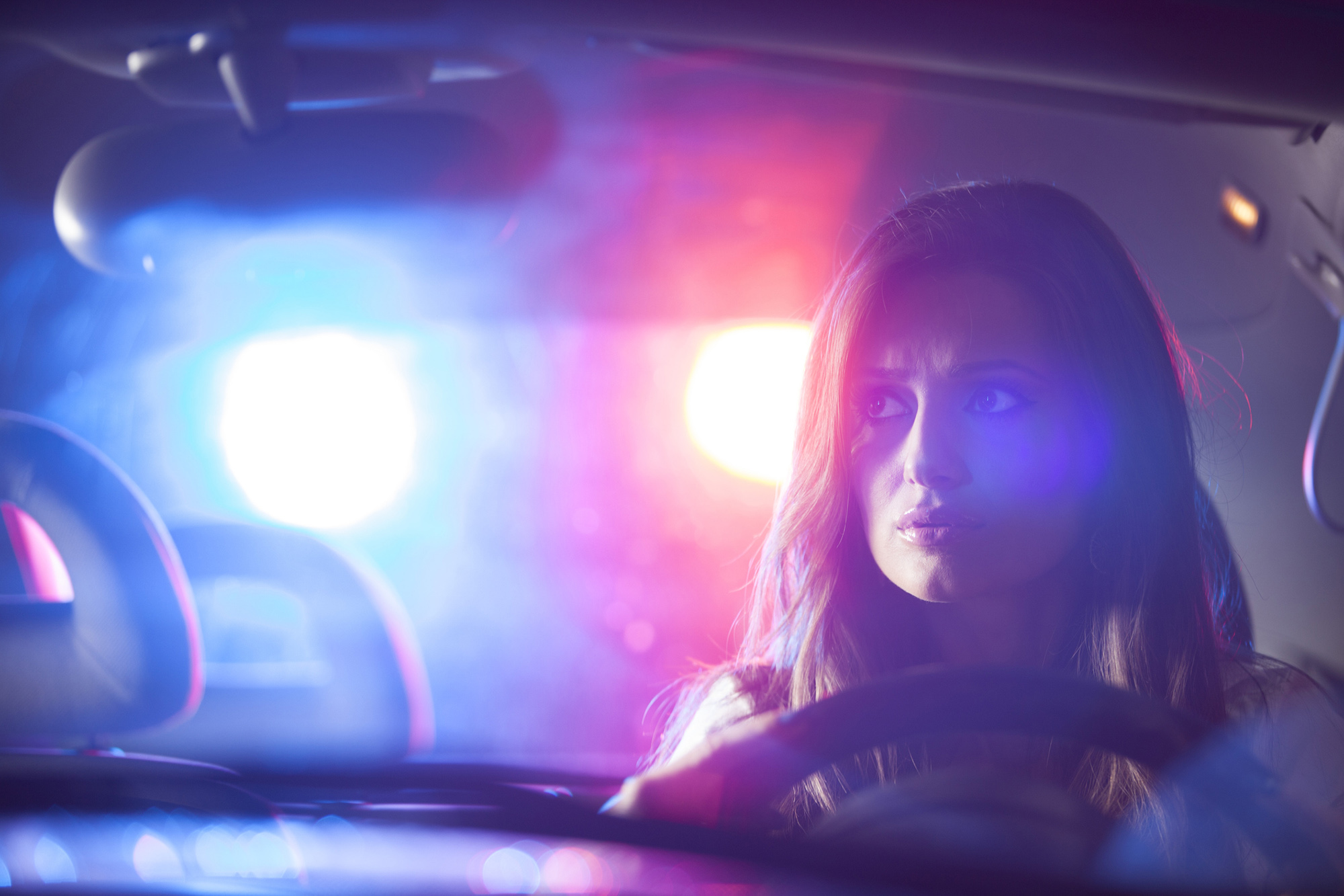 woman getting pulled over and in need of a Personal Injury Attorney & Criminal Defense